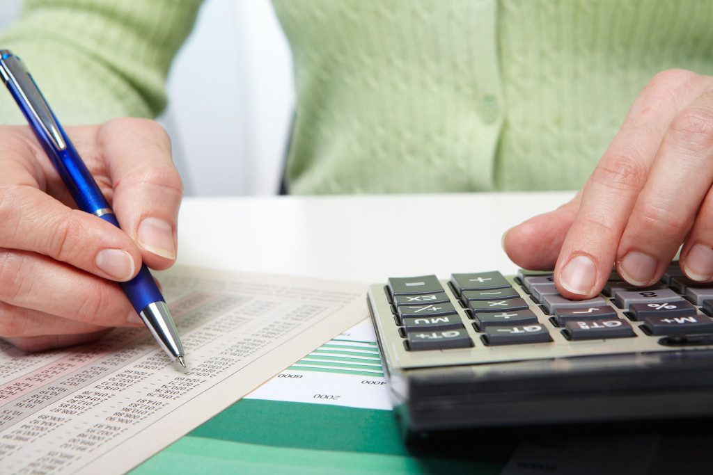 Businesswoman working in the office with calculator