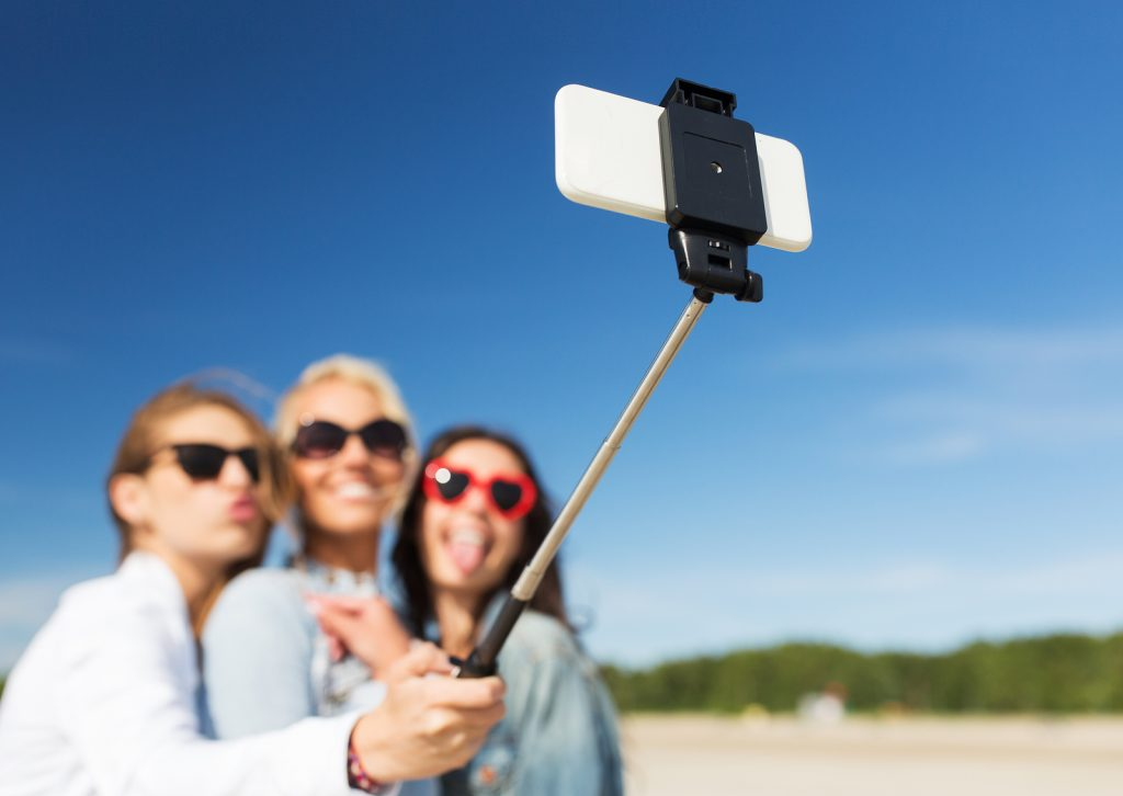 Female friends taking selfie during vacation