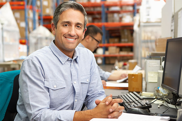 Small business owner smiling.